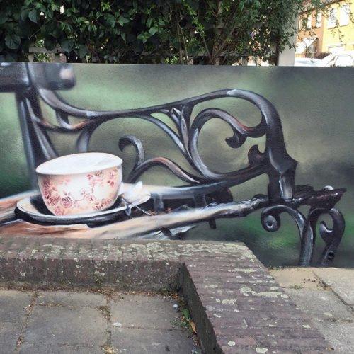 muurschildering tuinbank koffie geleen