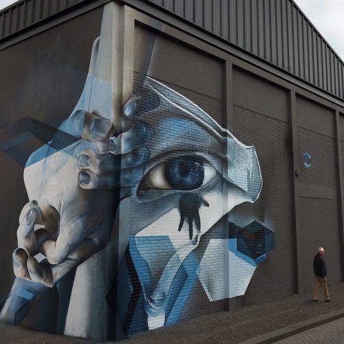 Streetart graffiti muurschildering Theater buitengevel Evertshuis Bodegraven marcus gomad debie