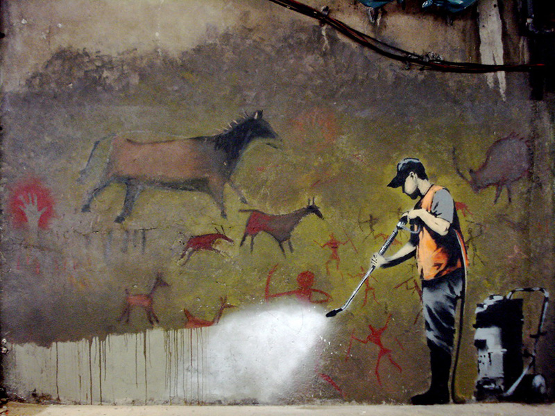 banksy cleaning cave paintning